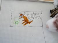 Kunst: Wiesel malt das Wappen von Wieselland, damit das Fussballspiel gegen die Schweiz auch korrekt beflaggt wird.